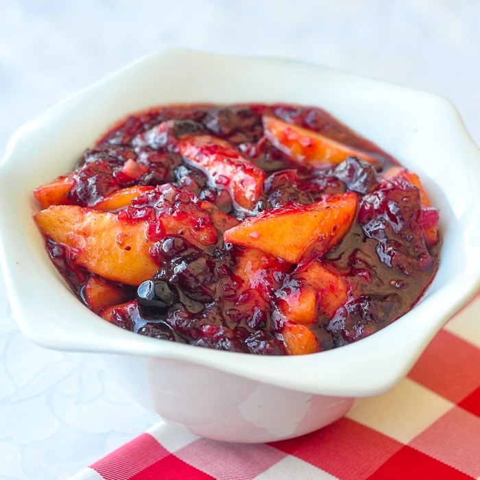 Cranberry Peach Chutney in a white serving bowl