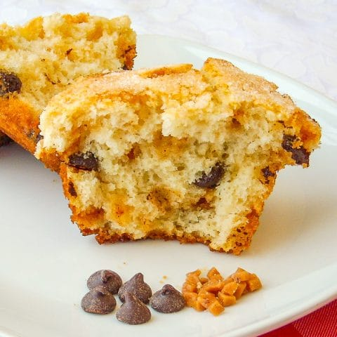 Toffee Chocolate Chip Muffins photo of one muffin split open on a white plate