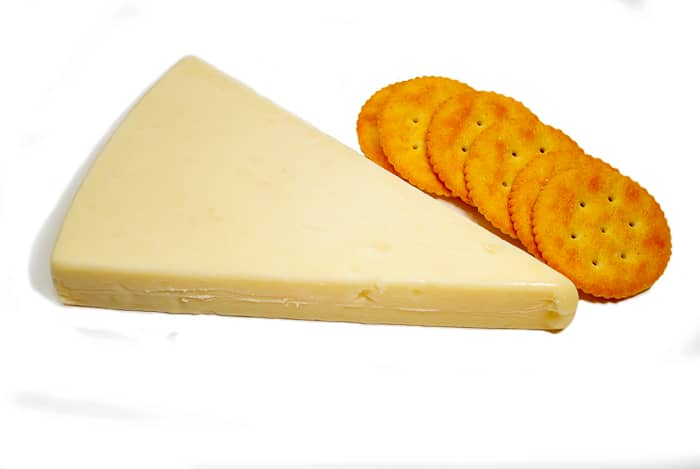 Asiago Cheese with Round Crackers stock image