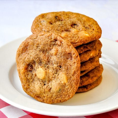 Toffee Coffee Chocolate Chip Cookies stacked on a white plate