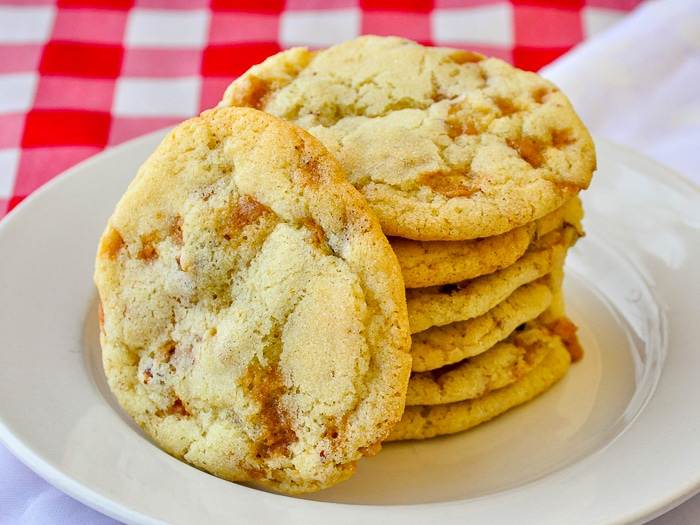 Toffee Pecan Cookies stacked on a white plate