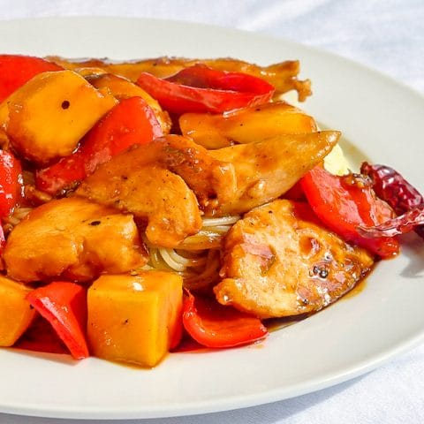 Quick and Easy Mango Chicken close up photo on white plate