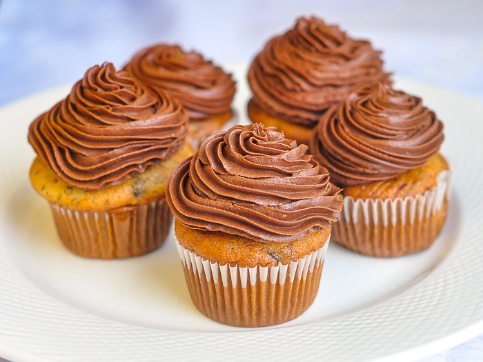 Double Chocolate Banana Cupcakes photo of five cupcakes on a white plate.