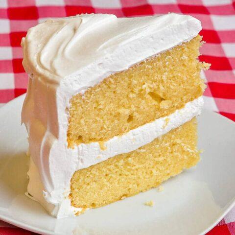 The best vanilla cake, single slice on white plate.