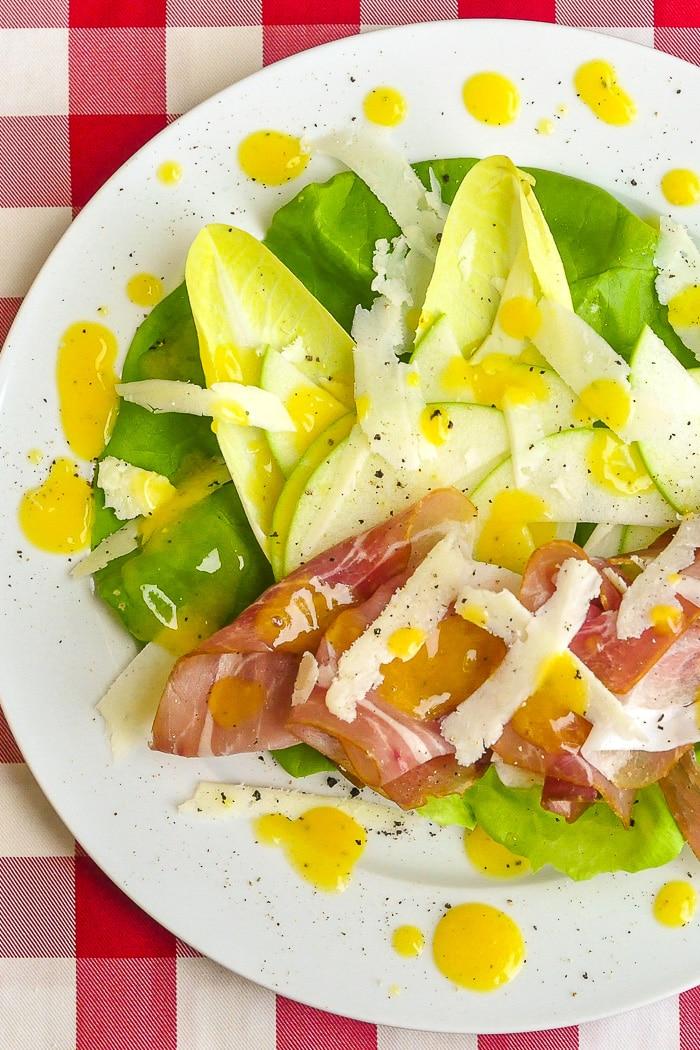 Mango Orange Dressing on Prosciutto Apple Salad long cropped photo for Pinterest