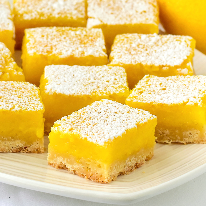 Close up photo of a platter of Super Easy Lemon Bars
