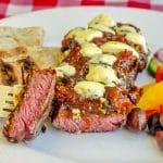 Blue Cheese Steak Puttanesca cut to show medium rare inside