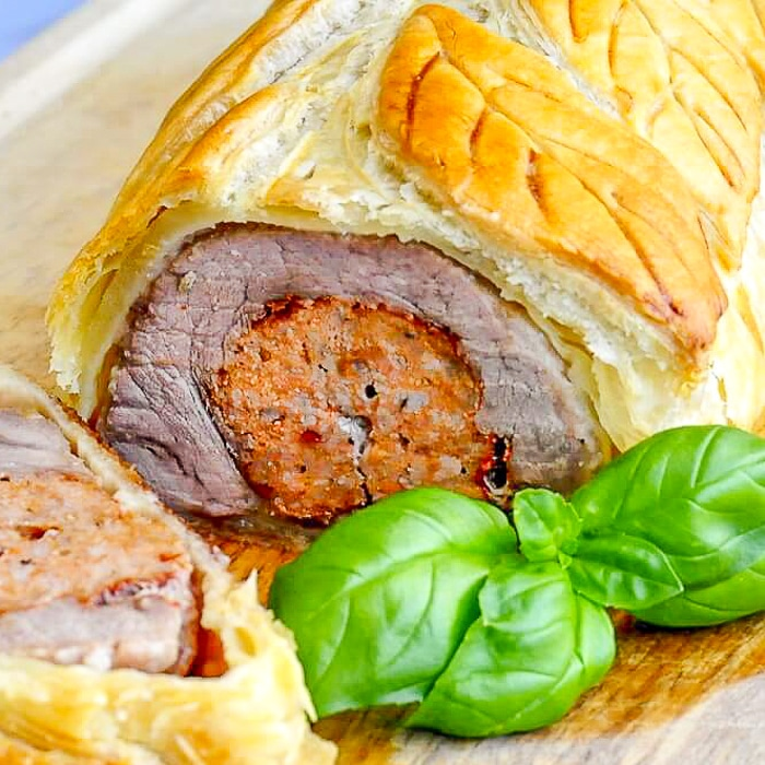 Sausage Pork Tenderloin Wellington close up photo of sliced wellington for featured image