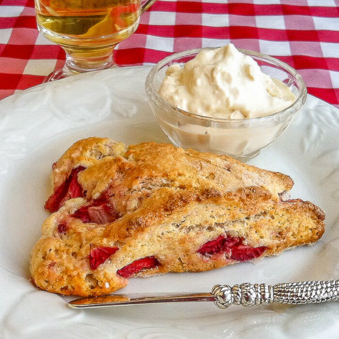 Strawberry Shortcake Scones shown on white plate with clotted cream