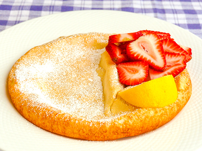 Dutch Baby side view photo of a single serving
