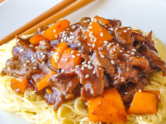 Five Spice Ginger Beef close up image served on thin noodles
