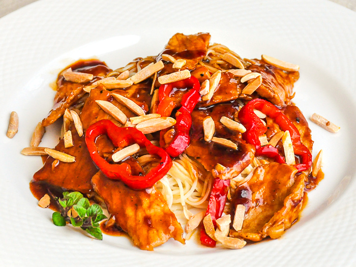 Kung Pao Pork photo of one serving on a white plate