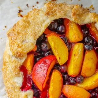 Blueberry Peach Summer Fruit Galette close up photo of filling and pastry