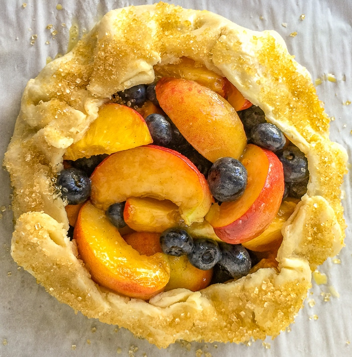 Blueberry Peach Summer Fruit Galette ready for the oven