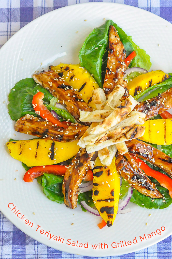 Chicken Teriyaki Salad with Grilled Mango photo of a single serving with title text added for Pinterest