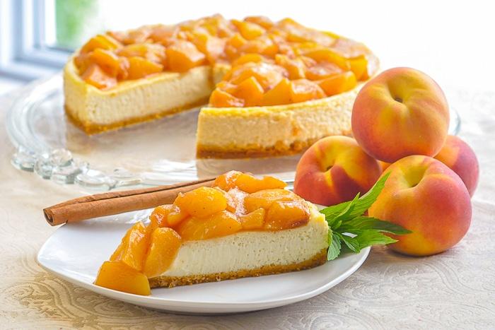 Peaches and Cream Flan wide shot photo near a sunny window