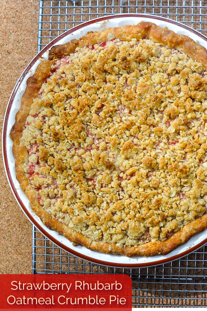 Strawberry Rhubarb Pie with Oatmeal Crumble Topping photo of uncut pie with title text added for Pinterest