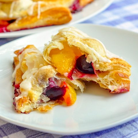 Easy Cherry Peach Turnovers close up photo of one turnover broken open to show filling