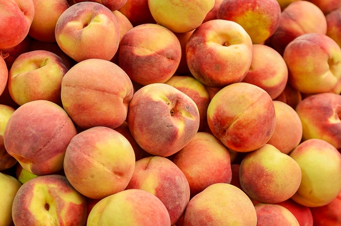 close up of peaches on market stand. Stock Photo