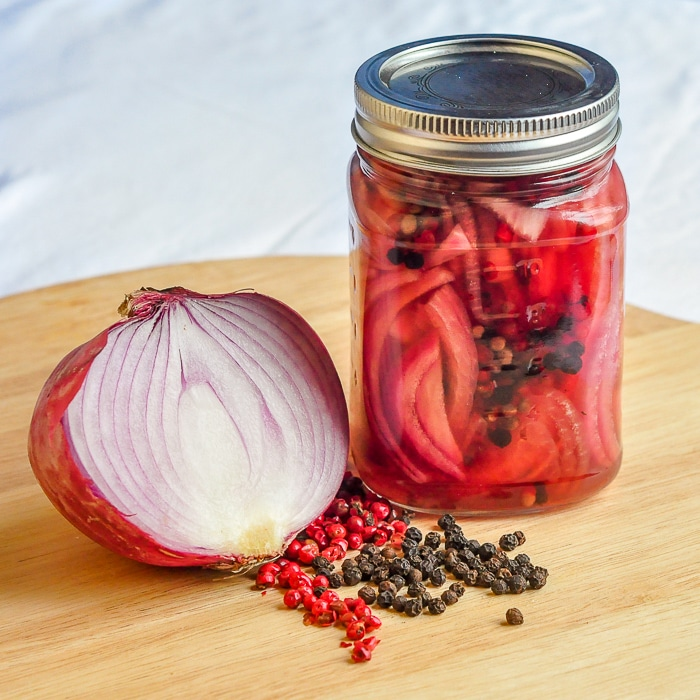 Pickled red onion in mason jar for Pulled Chicken Sandwiches
