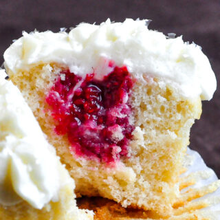 Raspberry Vanilla Cream Cheese Cupcakes close up photo of inside of cupcake