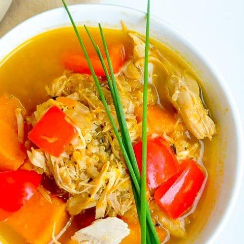 Turkey Quinoa Sweet Potato Soup close up photo of singe serving in a white bowl