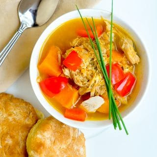 Turkey Quinoa Sweet Potato Soup shown with buttermilk biscuits on the side