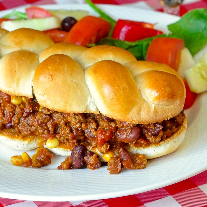 Chipotle Chili Sloppy Joes close up photo of a single sandwich on a white plate