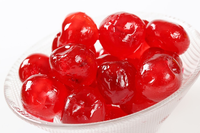 Red Glacé Cherries for Cherry Vanilla Cheesecake Bars, pictured in a glass bowl.