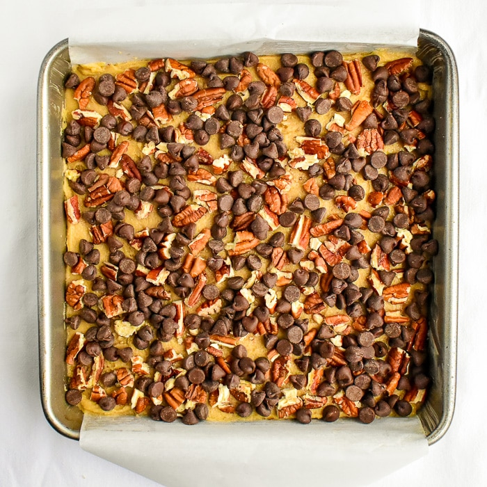 Simple sprinkle the pecans and cjhocolate chips over the top and bake