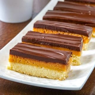 Twix Cookies on a white serving plate.