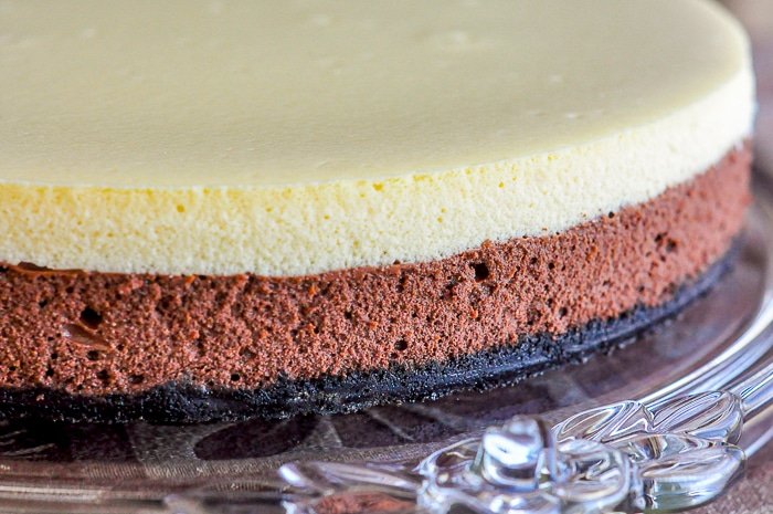 Black and White Cheesecake on a clear glass serving platter