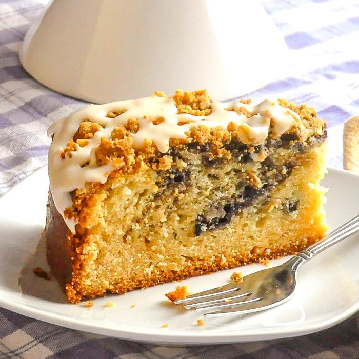 Blueberry Swirl Coffee Cake photo pd a single slice on a white plate