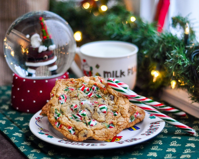 Chocolate Chip Candy Cane Cookies pictured with a glass of milk left out for Santa.