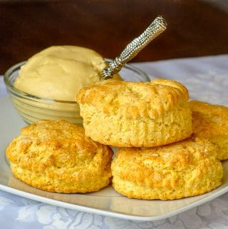 Corn Flour Biscuits on a white plate with maple butter in the background