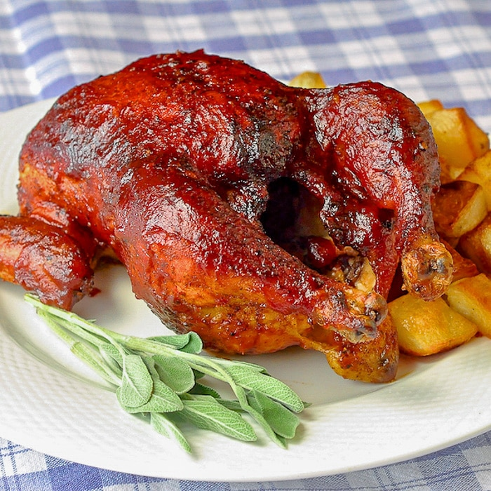 Maple Chipotle Barbecue Sauce shown on a whole barbecued chicken