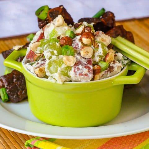 Lemon Waldorf Potato Salad in a single serving green dish