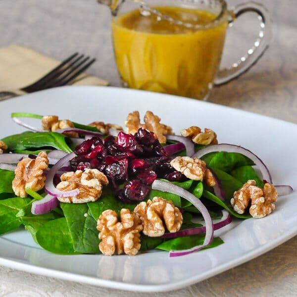 Dijon Maple Dressing on Cranberry Walnut Spinach Salad