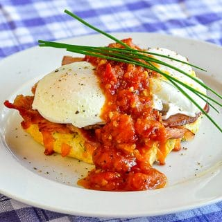 Cheddar Chive Biscuit Eggs Benedict photo of single serving on a white plate