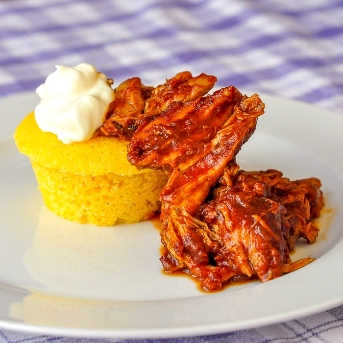 Chili Pulled Pork with Cornbread featued image of single serving on white plate