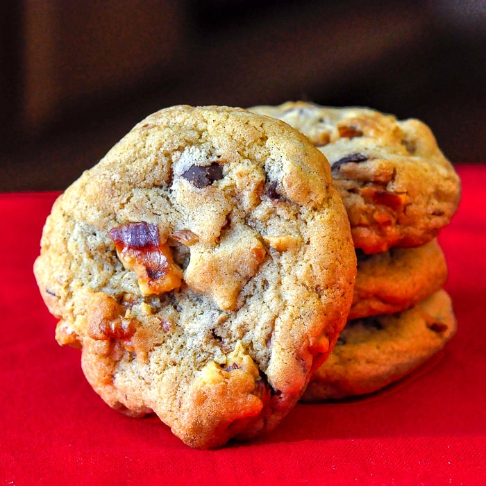 Walnut Chocolate Chip Cookies stacked on red napkin.
