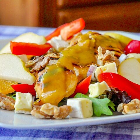Honey Dijon Chicken Salad with Brie and Walnuts close up photo of prepared salad on a white plate