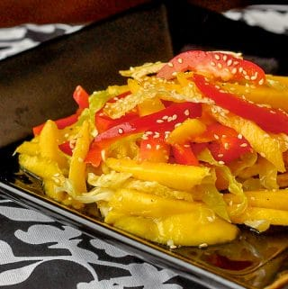 Mango Sesame Coleslaw shown on black serving plate