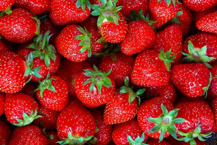 Fresh strawberries close up photo.