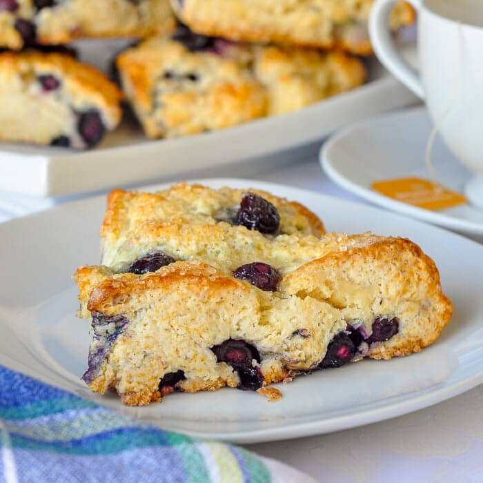 Blueberry Cheesecake Scones on a white plate.