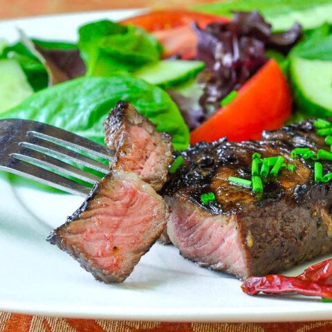 Garlic and Five Spice Grilled Steak close up photo of cut steak