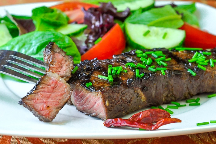 Garlic and Five Spice Grilled Steak shown with a side salad
