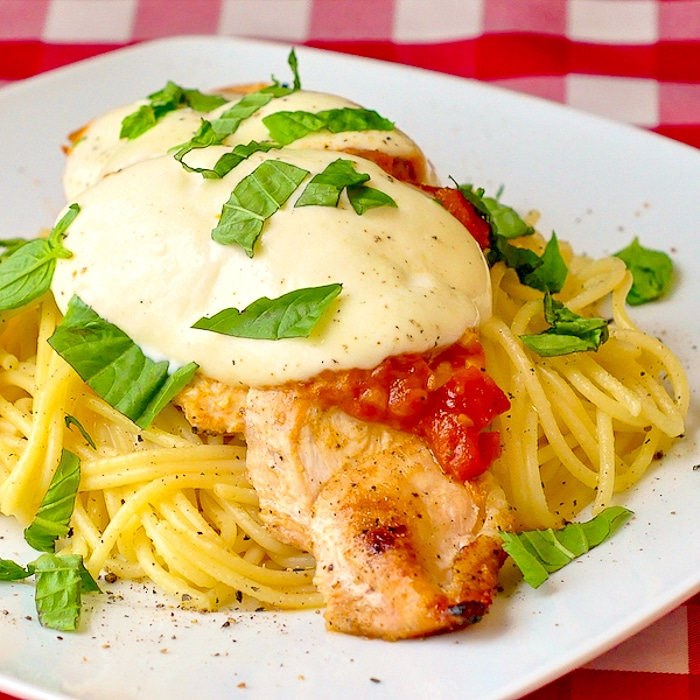 Grilled Chicken Margherita Spaghetti photo of a single serving on a white plate