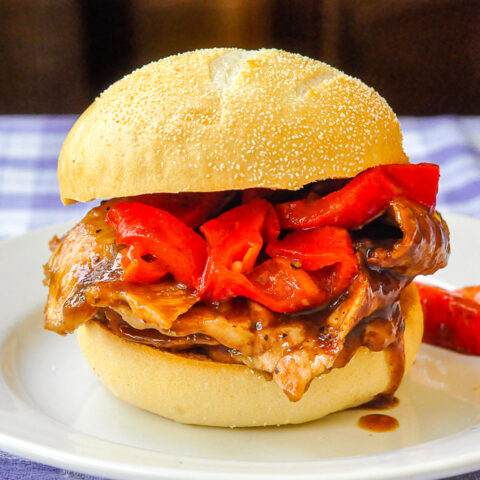 Orange Hoisin Pork Sandwiches photo of one sandwich on a white plate