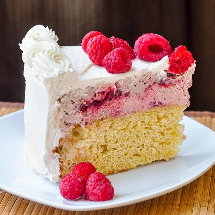 Raspberry Swirl Cheesecake Shortcake photo of a single slice on a white plate
